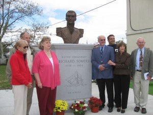 Members of the Somers Point Historical Society gather around a bronze bust of Richard Somers.  Somers was a naval hero, perishing during battle in 1804 during the First Barbary War.  Photo courtesy of Lois Gregory.